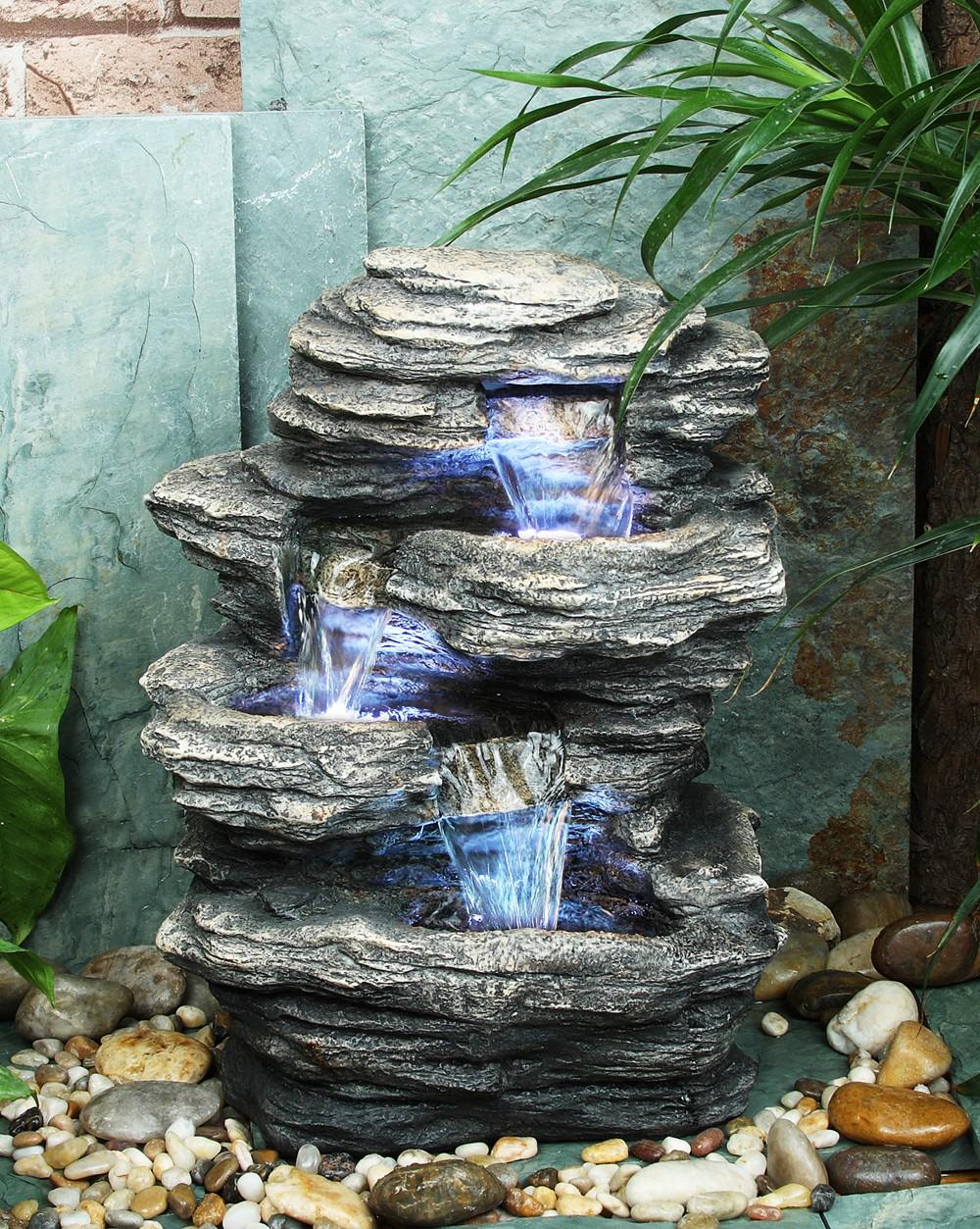 Dreistufiger wasserfall brunnen mit led beleuchtung in steinoptik for Brunnen wasserfall garten